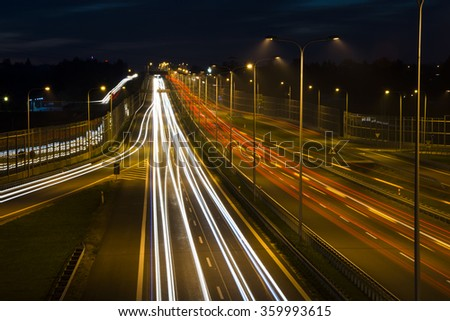 Car lights on a highway at night