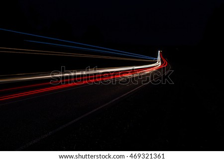 Car lights on night road track