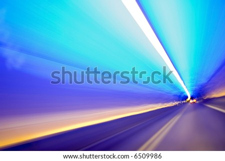 Car lights trails in a tunnel - long exposure photo taken in a tunnel - stock photo