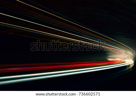 Car ligth trails. Art image. Long exposure photo taken in a tunnel