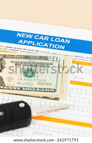Car loan application with car key and dollar banknote; document is mock-up - stock photo