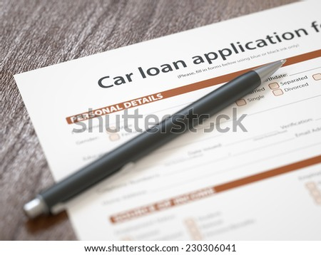 Car loan application with pen - stock photo