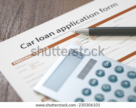 Car loan application with pen and calculator - stock photo