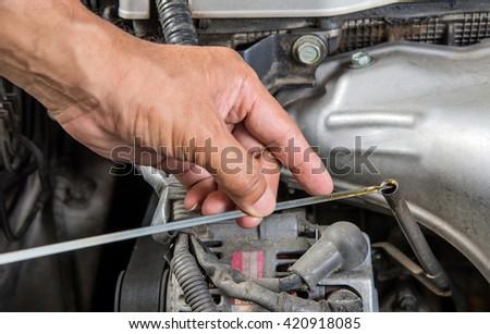 Car lubricator check,Car maintenance,Check  car yourself,Check lubricator self. - stock photo