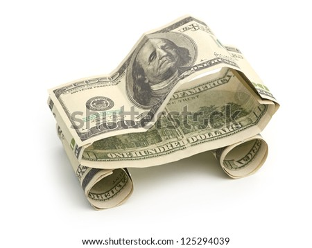 car made from dollar isolated on white background - stock photo