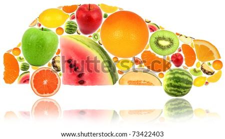 Car made of fruit isolated on white - stock photo
