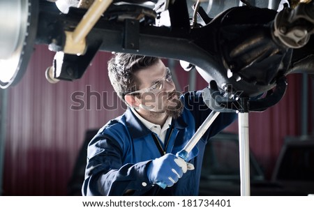 Car mechanic at work - stock photo