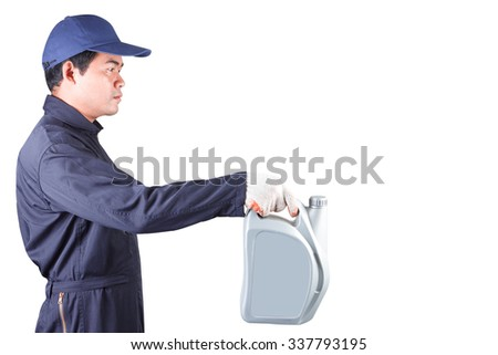Car mechanic holding gray canister with engine oil isolated on white background with clipping path - stock photo