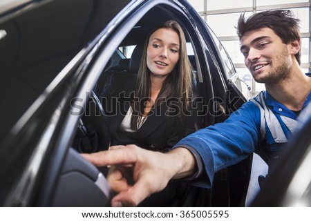 Car mechanic point out towards the customer what the problem was and gives customer support.