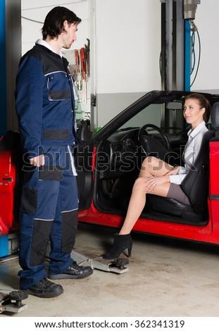 Car mechanic with female customer - stock photo