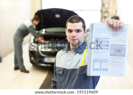 Car mechanic working in auto repair service. Selective focus. - stock photo
