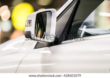 car mirror, side rear-view mirror on a modern car  - stock photo