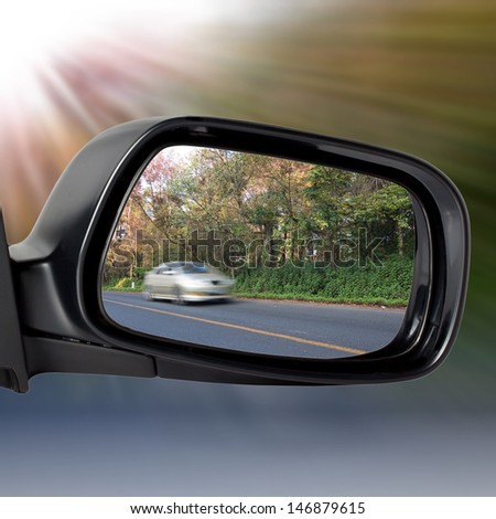 Car Mirror with Concept of Speed  - stock photo