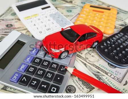 Car money and calculator. Payments and costs. - stock photo
