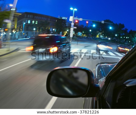 Car moving in traffic city street at rush hour - stock photo