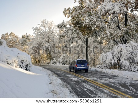 car navigating winter road