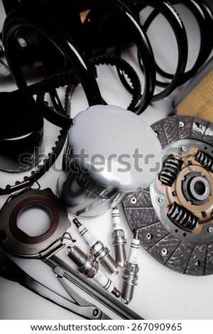 Car. New car parts on a gray background - stock photo