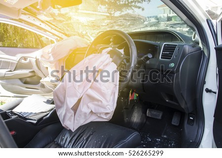 Car of accident Make airbag explosion damaged at claim the insurance company. Working car repair inspection at damaged of accident. Claim the insurance company. image blur focus style.