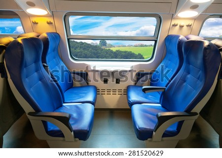 car of the train of the long-distance message with a beautiful view from the window - stock photo
