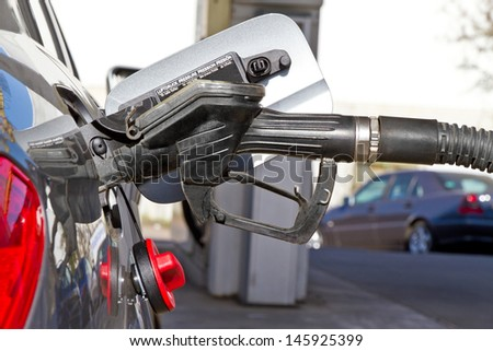 Car on a fuel station - stock photo