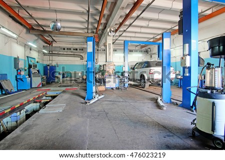 Car on a lift in a car repair station in Moscow, Russia