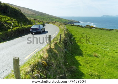Car on an Irish road at Beara - stock photo