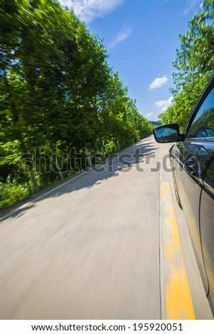 car on country road under blue sky
