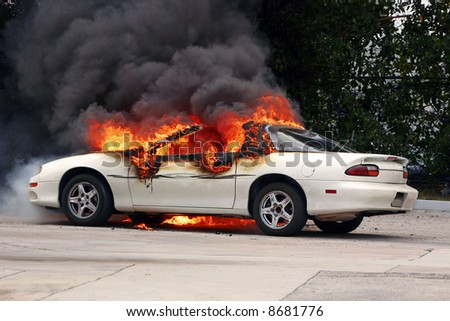 Car on fire - [early stage of a fire] - stock photo