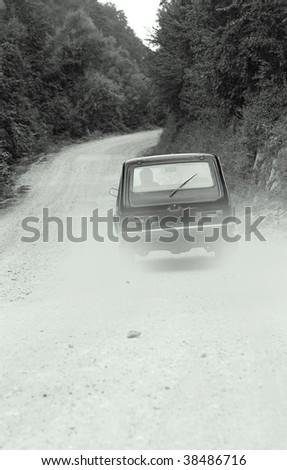 Car on forest road - stock photo