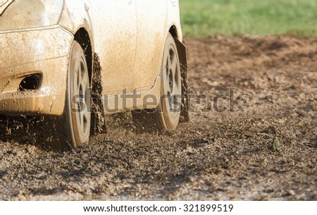 car on muddy road - stock photo