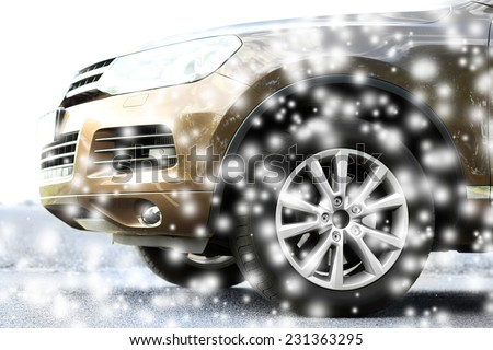 Car on road and snow - stock photo