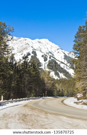 Car on road to Mount Norquay ski hill, Banff National Park, Alberta, Canada - stock photo