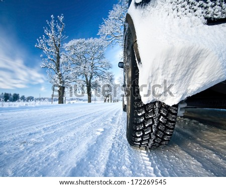 Car on the countryside road - stock photo