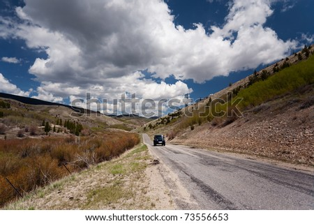 Car on the road in Montana - stock photo