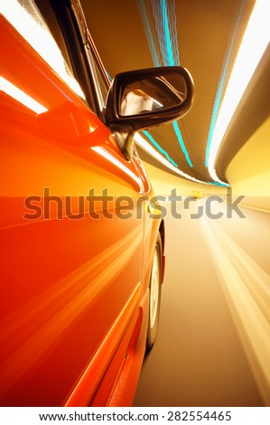 car on the road tunnel with motion blur background. - stock photo