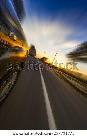 car on the road wiht motion blur background. - stock photo