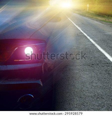 Car on the road with morning sun