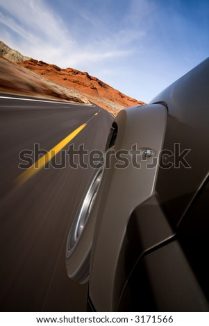 car on the road with motion blur, Bighorn Canyon, Wyoming - stock photo