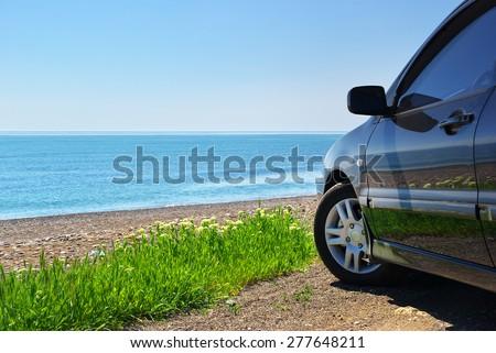 Car on the sea shore. Travel design. - stock photo