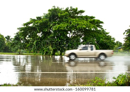 Car on wet roads - stock photo