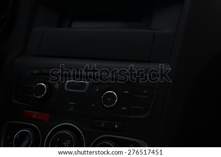Car panel with buttons.  Audio system. Interior