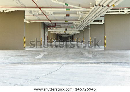 Car park under the building - stock photo