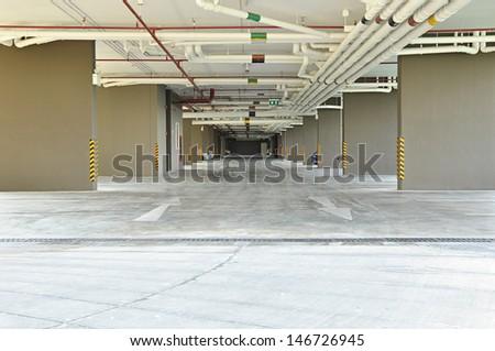 Car park under the building - stock photo