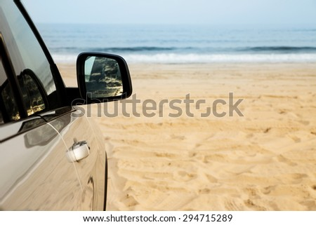 Car parked on the beach. Vacation, summer, adventure, outdoors concept.  - stock photo