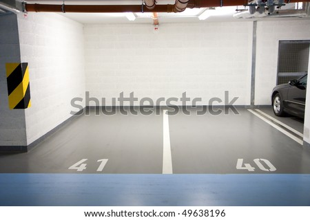 Car parking in an underground garage - stock photo