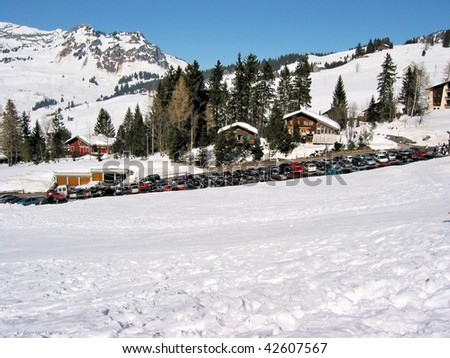 Car parking in Swiss Alps - stock photo