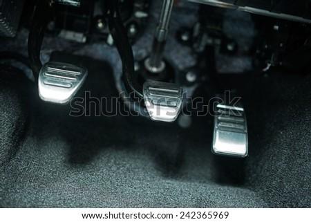 Car Pedals. Modern Car Clutch, Gas and Brake Pedals Closeup. - stock photo