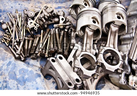 Car piston and a lot of different auto spare parts. - stock photo
