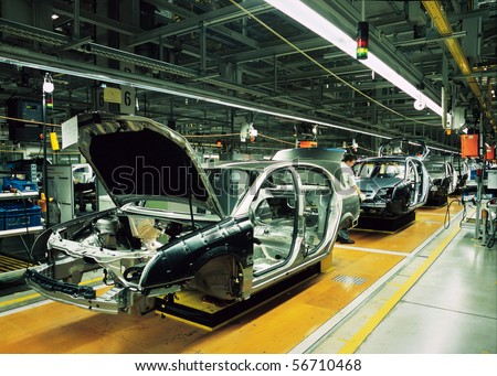 car production line with unfinished cars in a row - stock photo