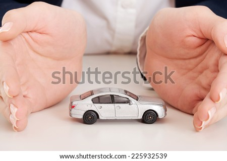 Car protection by a businesswoman - stock photo
